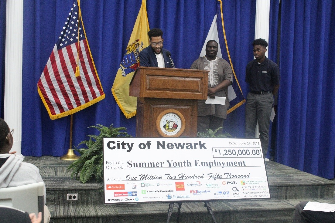 Newark youths share their experiences at the Mayor's Summer Youth Employment Program press event in City Hall.